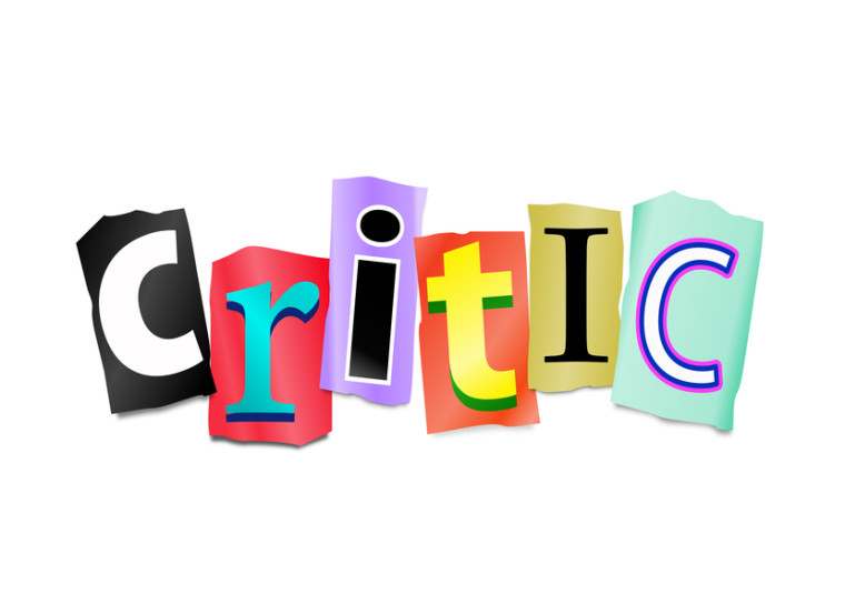 Illustration depicting cut out letters arranged to form the word critic.