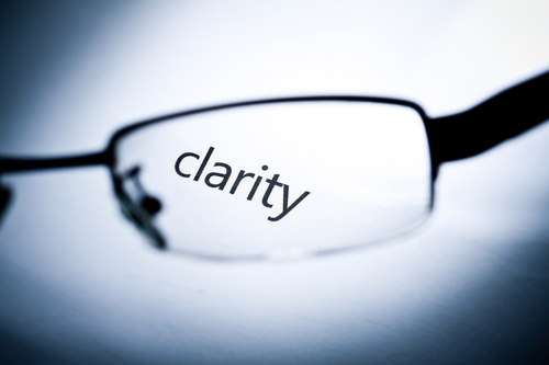 """Word """"clarity"""" viewed from a glasses."""
