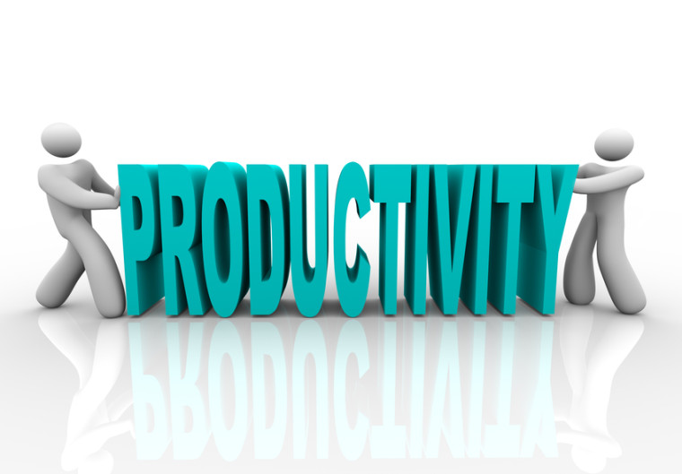 Two people push together letters to form the word Productivity
