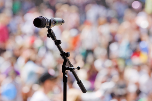 An open microphone awaits the next act at a summer music festival